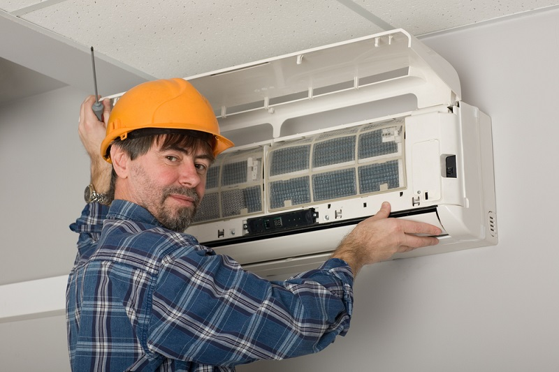 Best Air Conditioner man fixing