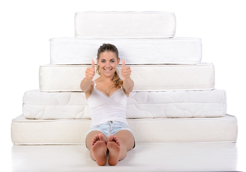Mattress Protector woman with thumbs up