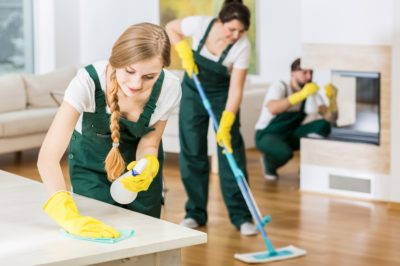 Professional Cleaning Services women scrubbing