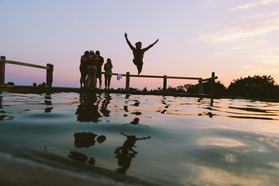 planned community jumping in water swimming