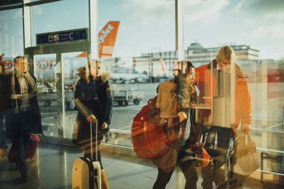 Summer Vacation woman standing alone in airport