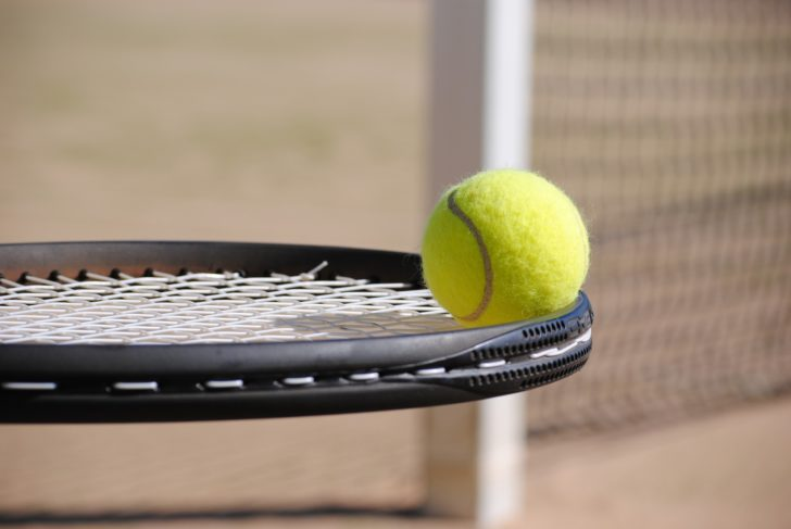 tennis break racket with ball on it