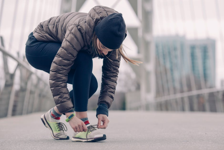 Improve Your Body lacing up running shoes