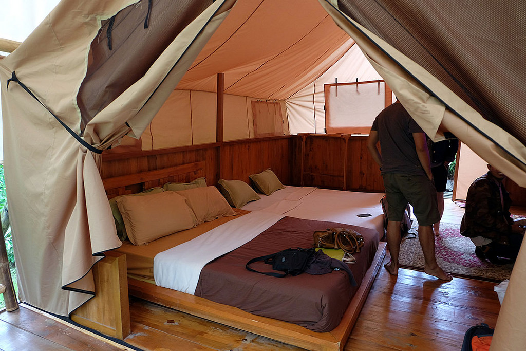 Glamping bedroom with curtain