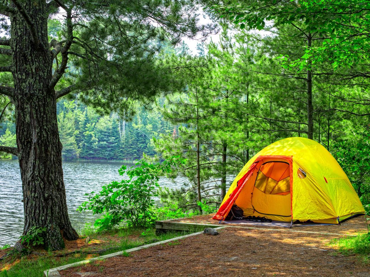 camping gear tent near lake