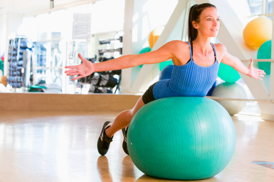 woman balancing on yoga ball