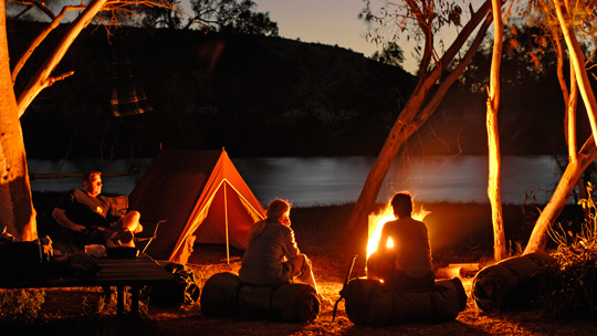 camping gear sitting by campfire