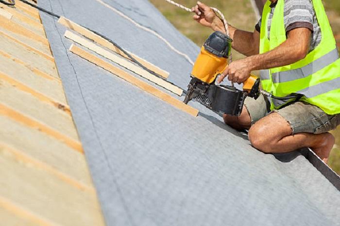 roof repairs man working