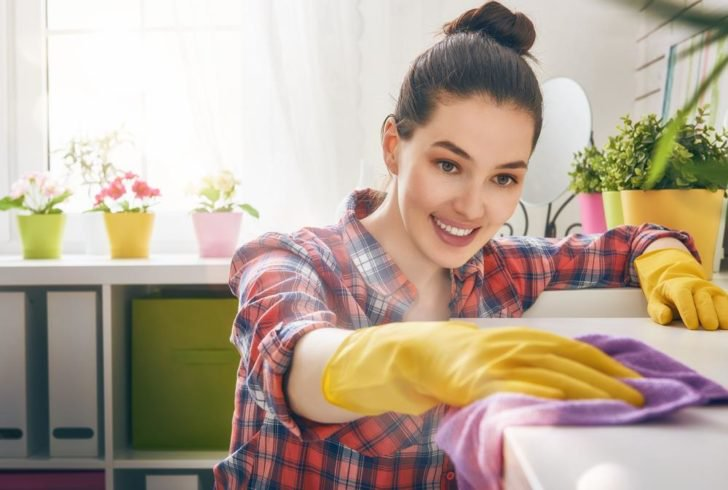 cleaning woman smiling and scrubbing