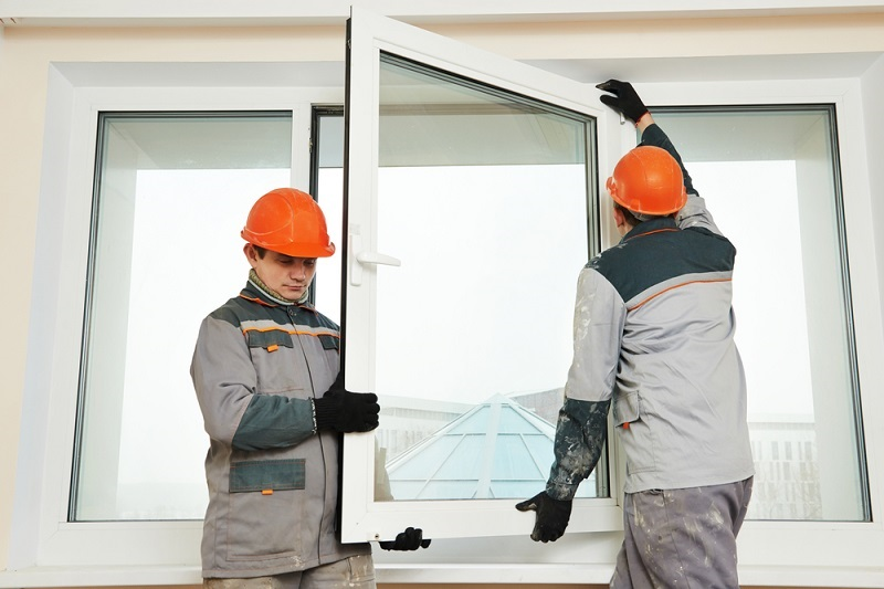 Glass Repair Service men carrying window
