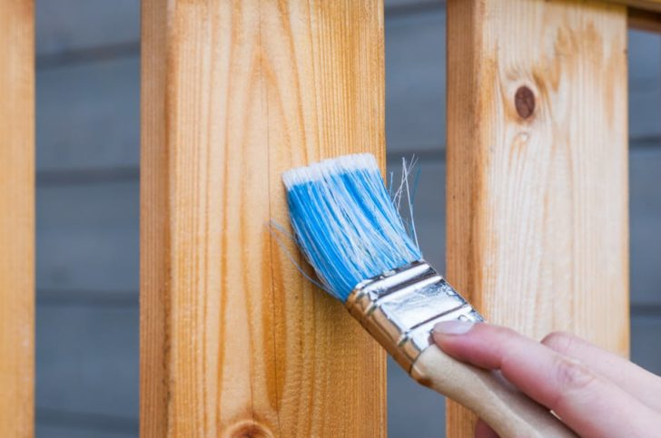 Home Renovation wood staining with brush