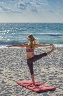 Yoga Teacher training on beach near lake