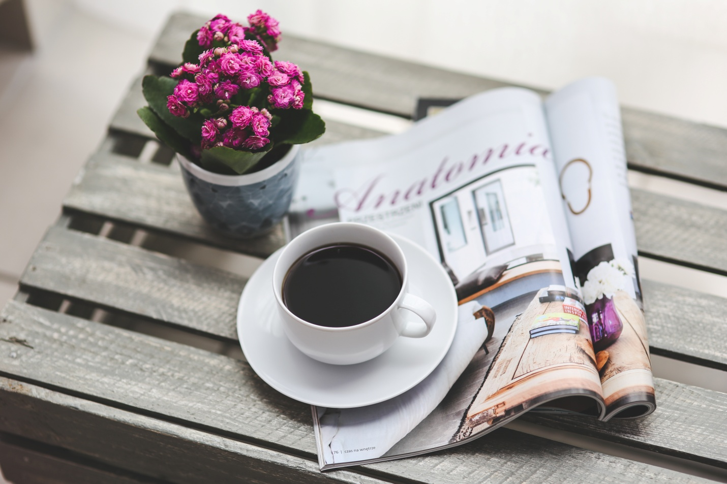 Coffee Makers cup of coffee with magazine