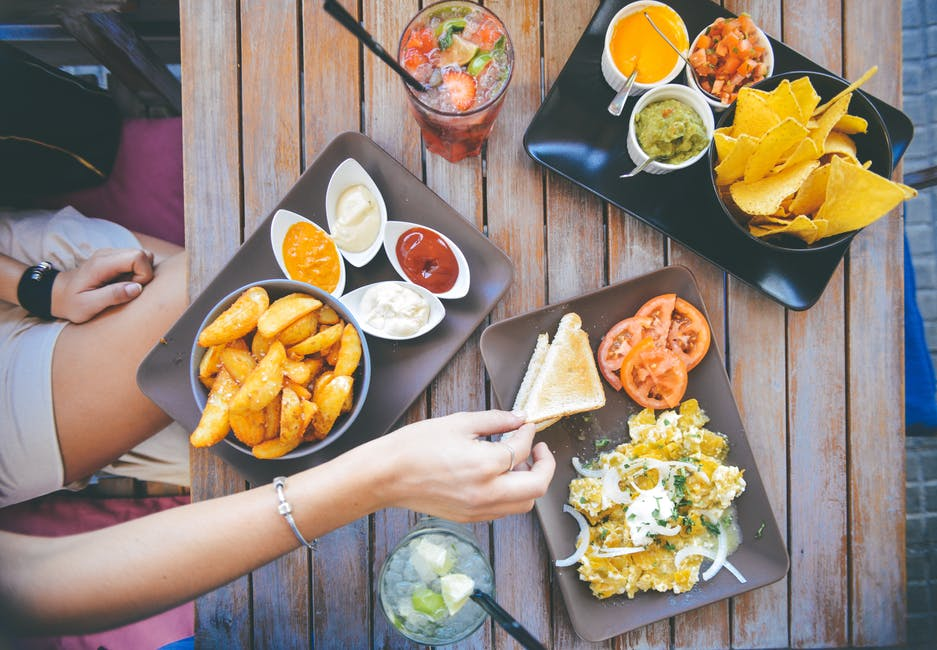 Top 5 Tips for Students Traveling in Europe eating chips