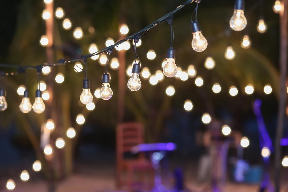 Revamp Your Outdoors lights hanging in the dark