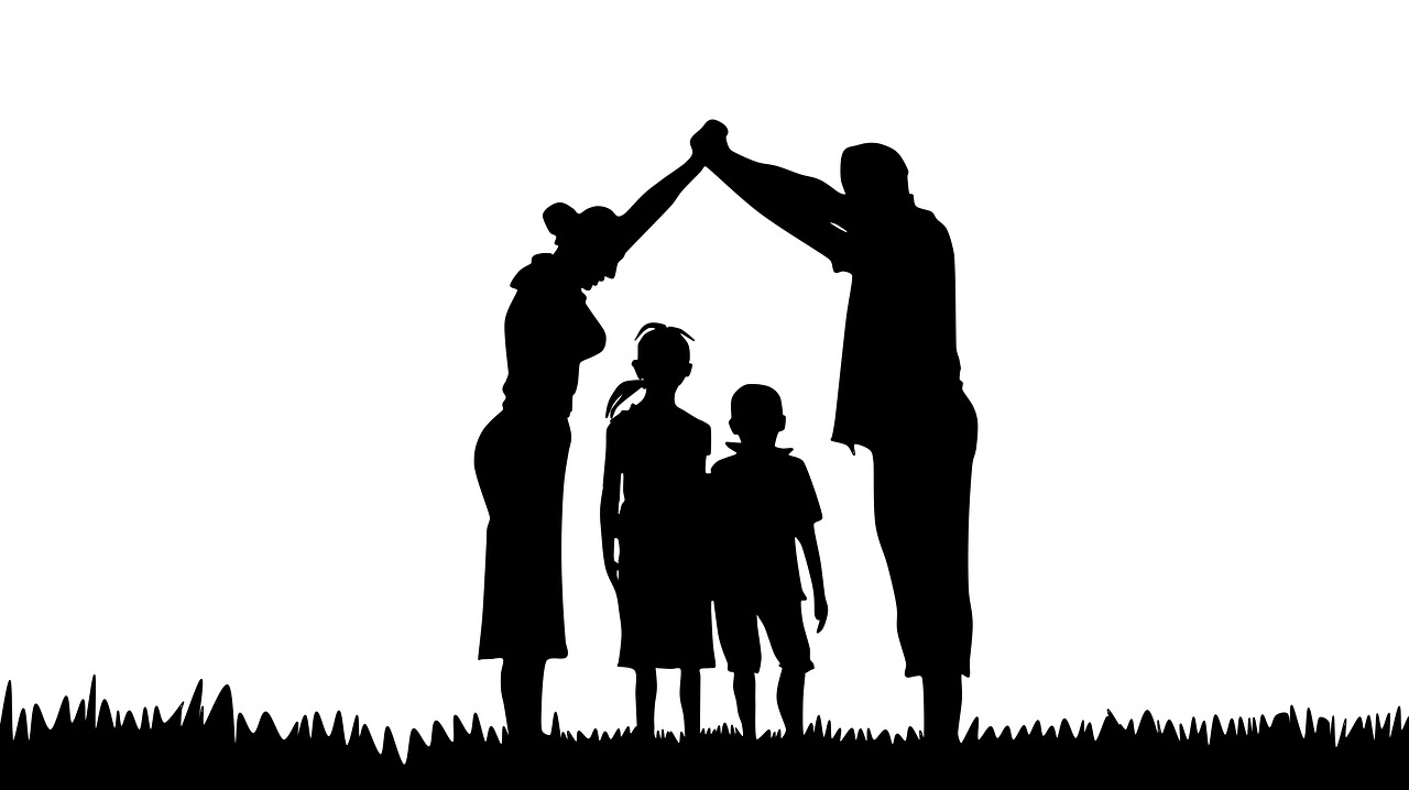 parents bridge over children silhouette