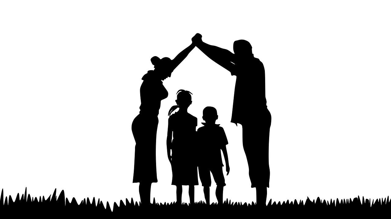 parents bridge over children silhouette