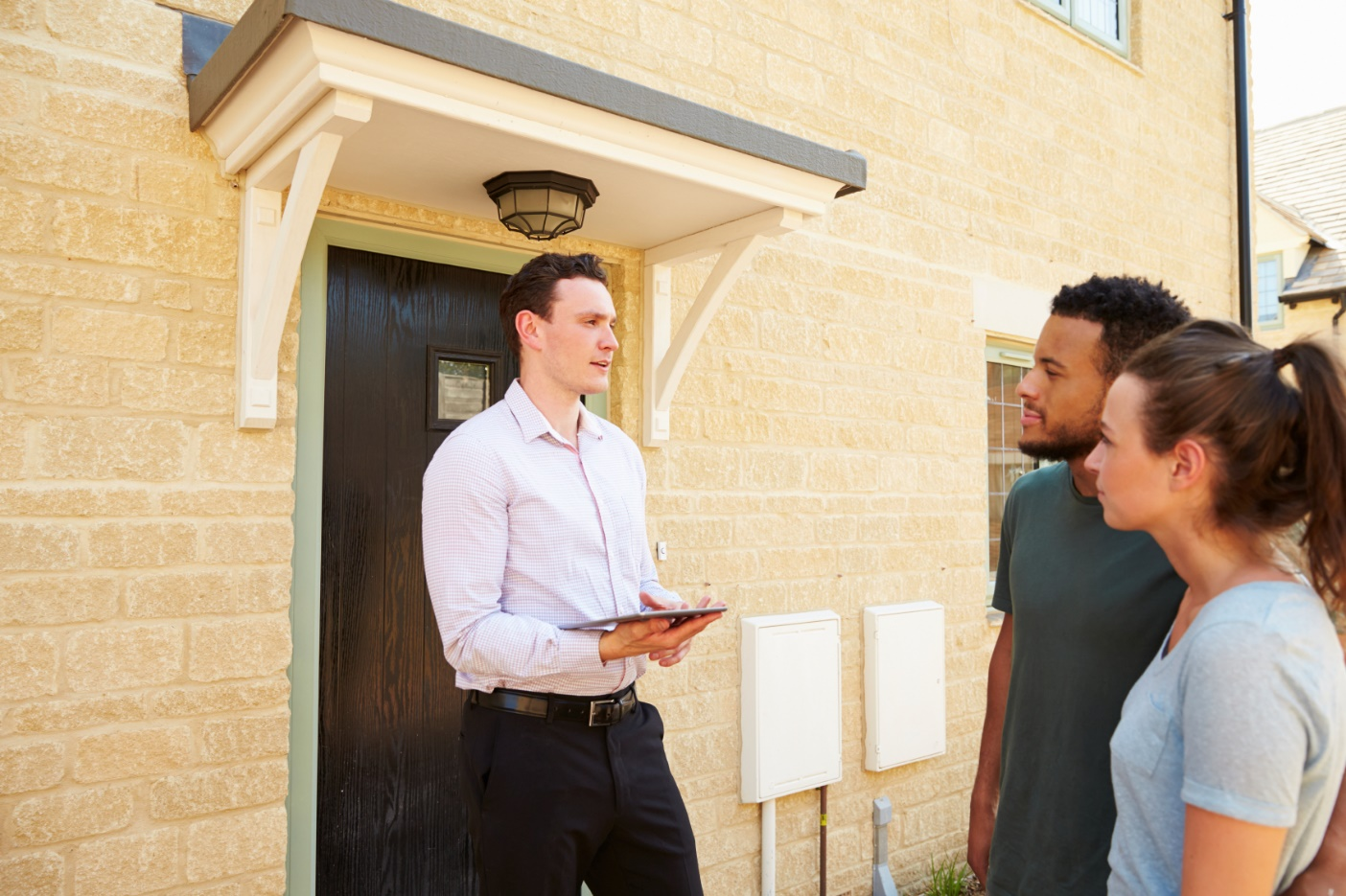 Selling your Home realtor outside of doorway