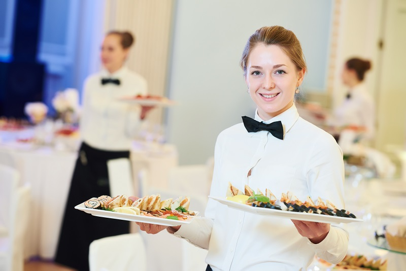 Catering Companies girl serving food