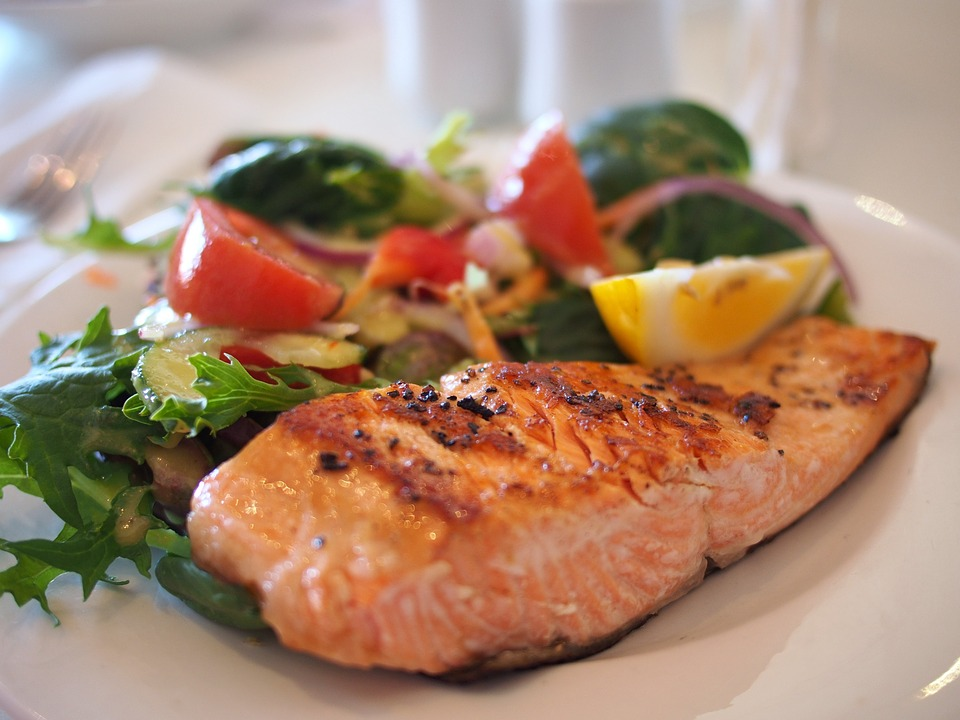eating healthfully salmon and vegetables after giving birth