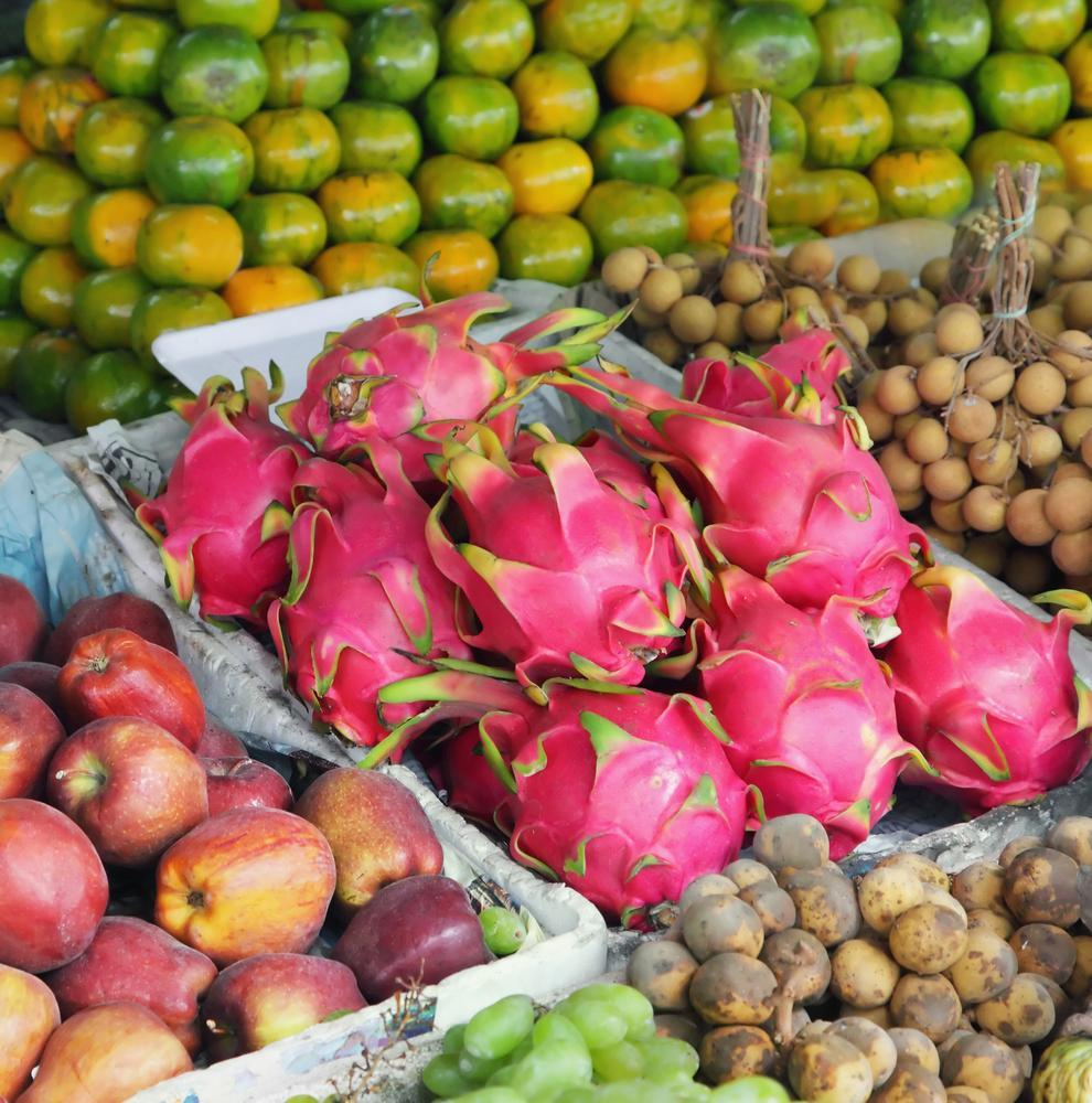 Dragon Fruit for sale in market stands