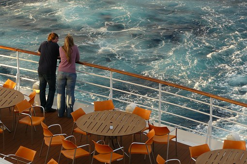 Things to Do on Your Honeymoon Trip to London on railing of cruise