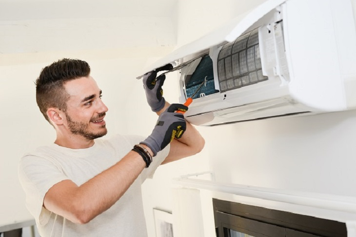 Ducted Heater installation man