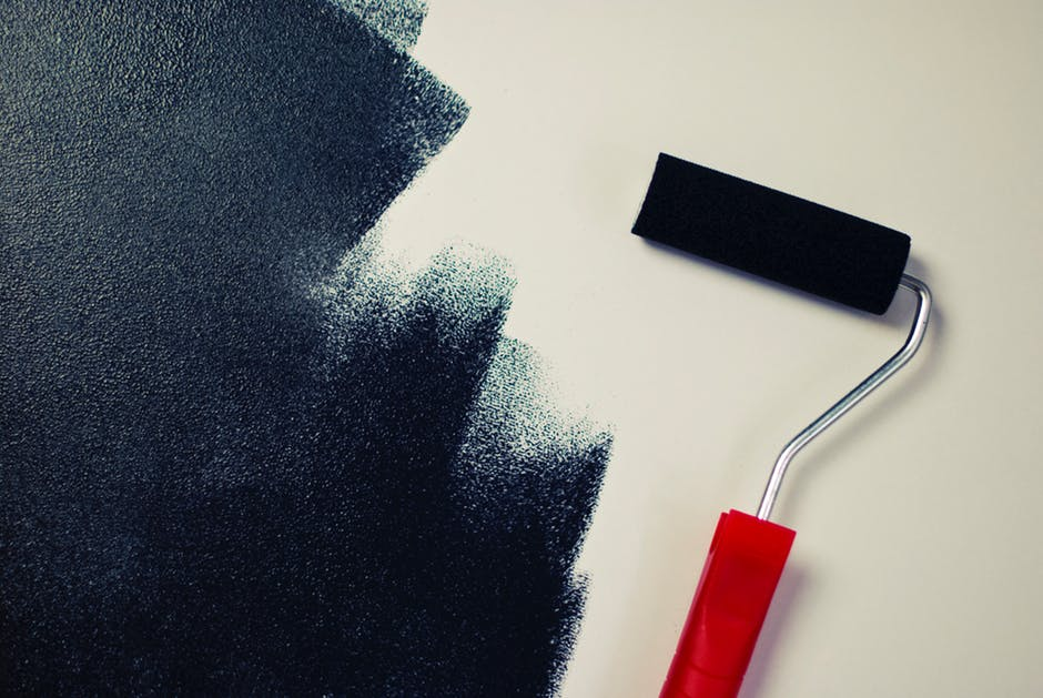 Home Renovation painting with roller and dark colors