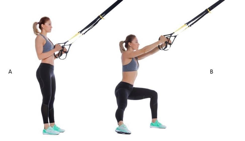 woman pulling trx strap