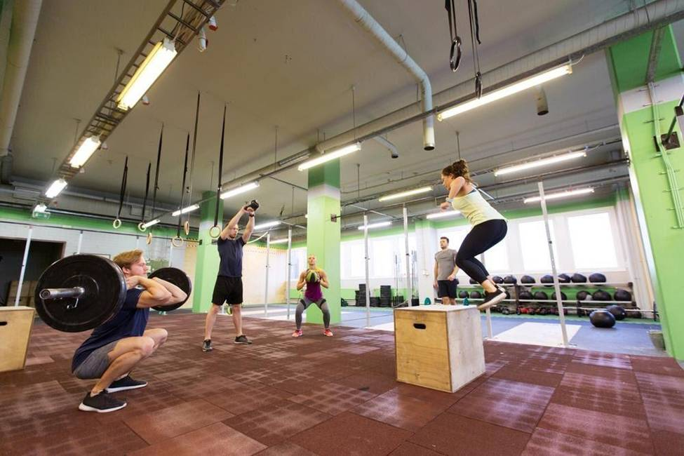woman box jumps in gym