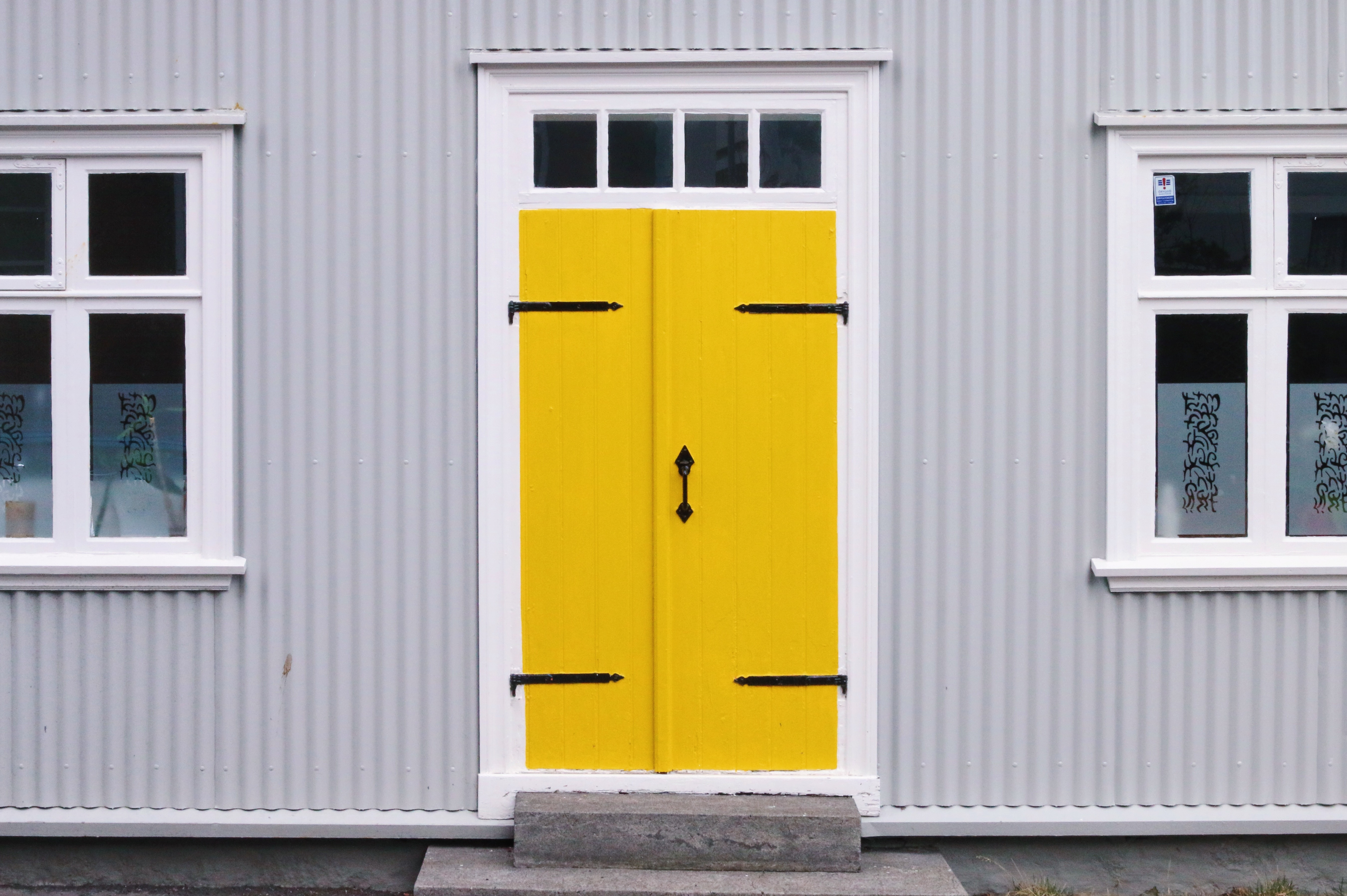 A Guide to Selling Your Home and Moving Fast grey outdoor with yellow door