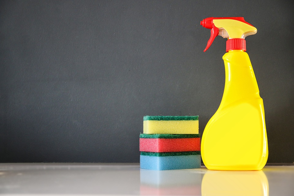 A Simple Cleaning Schedule You Can Stick To spray bottle yellow