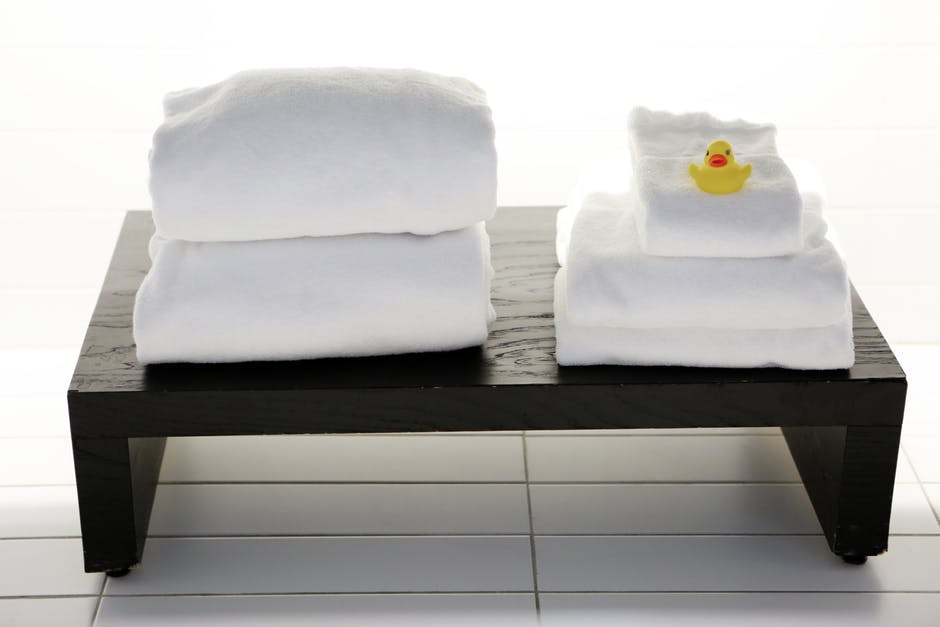 bath with towels on table