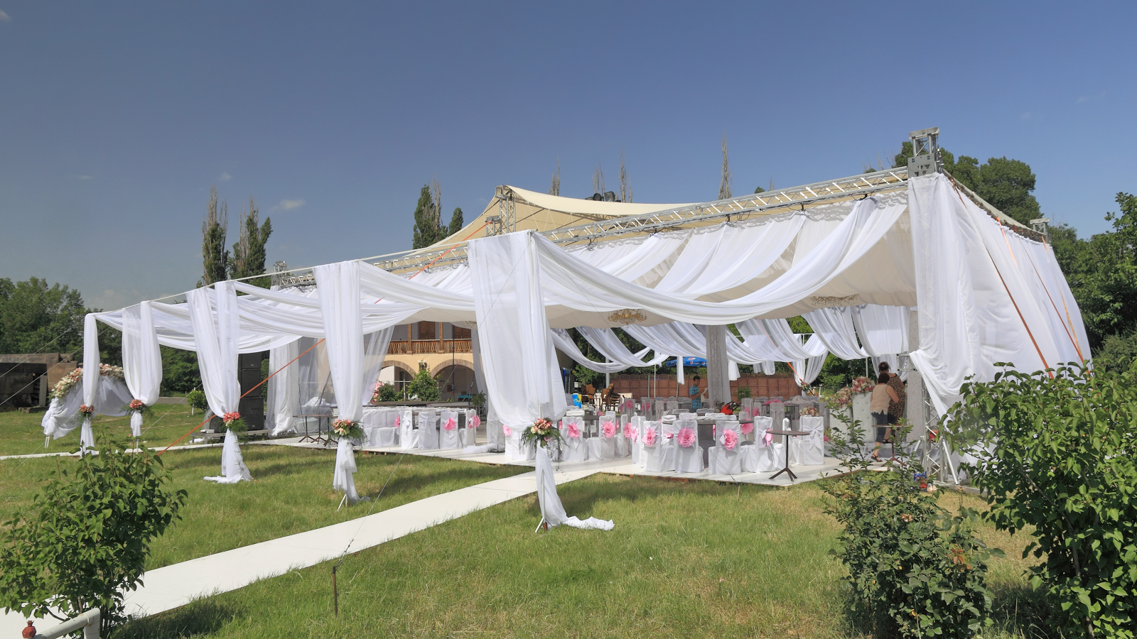 Nail These Three Elements For The Perfect At-Home Wedding Reception white tent outside