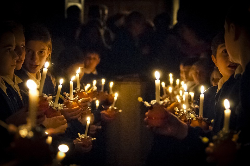 Your Survival Guide to Spending Christmas With the In-Laws candle light vigil