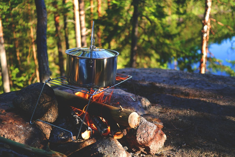 Why Everyone Should Go Camping Once In a Lifetime wood piled up