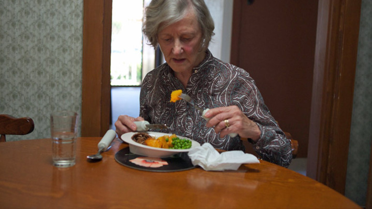 The Importance of Sharing Meals with Other Elders woman eating