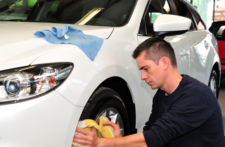 Keep Your Car Insurance Payments Low by Using These Tips To Avoid Accidents cleaning wheel