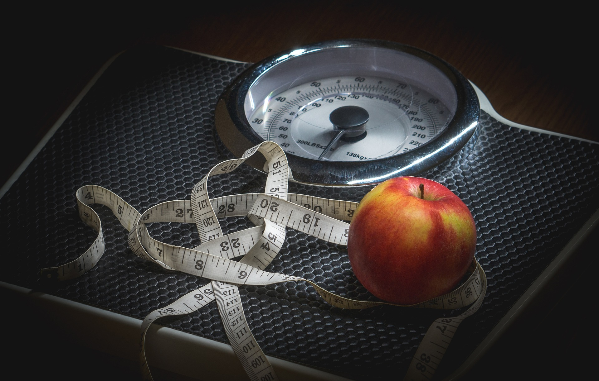Can MCT Oil Application Add Impetus To The Weight Loss Process apple and scale
