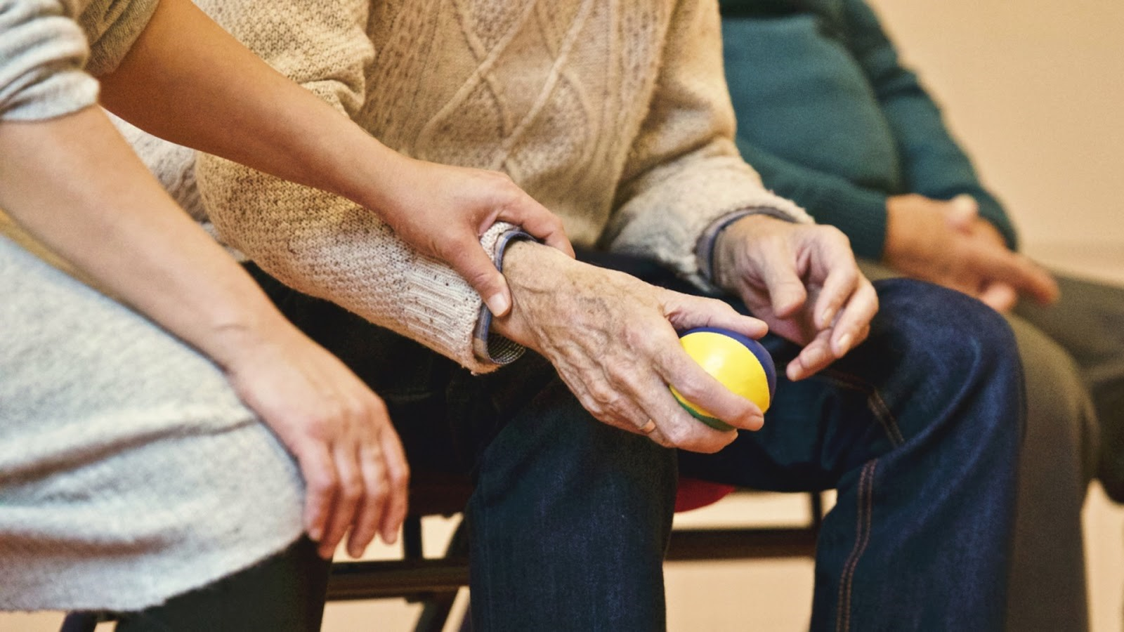 Helping Elderly Relatives Adjust to Life in a Retirement Home holding stress ball