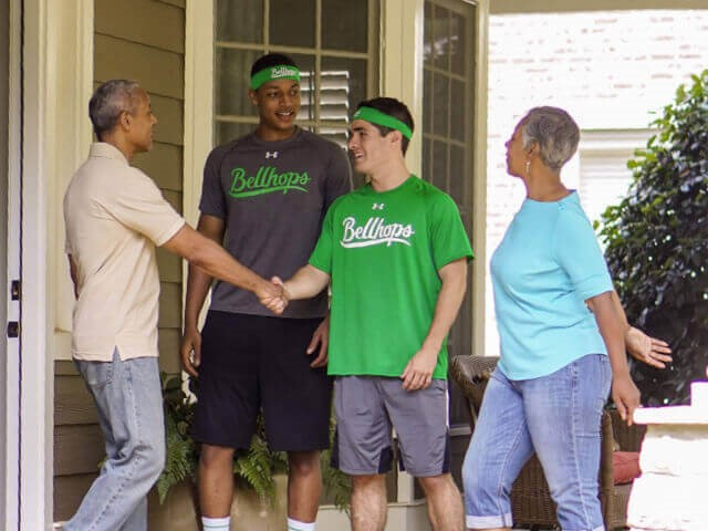 Getting employed in moving services consider Bellhops Moving shaking hands