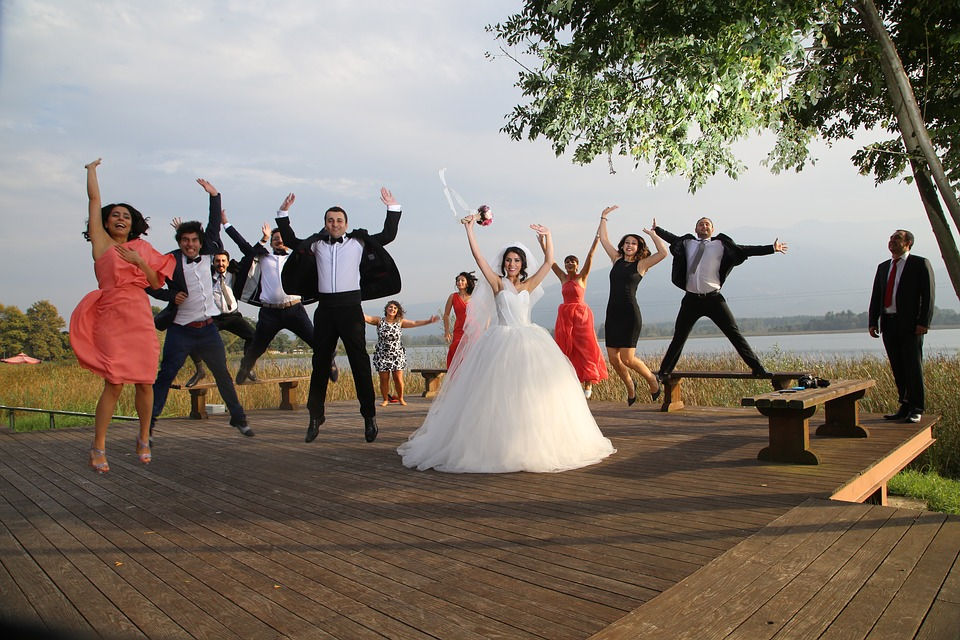 A Houston Wedding Photographer Covers Different Poses For Couples jumping