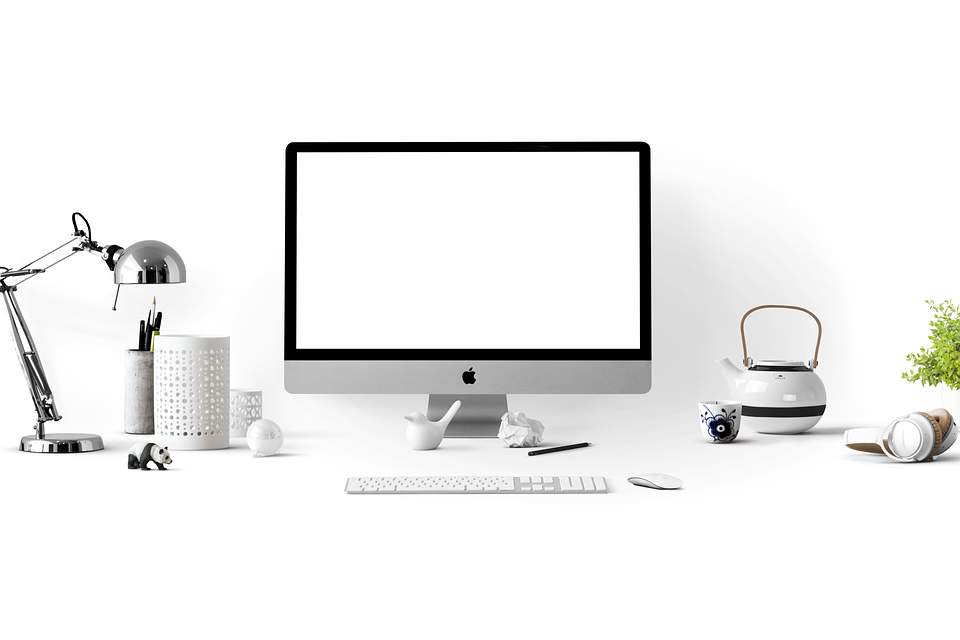 How to Decorate Your Office Space Based on Your Zodiac Sign macbook