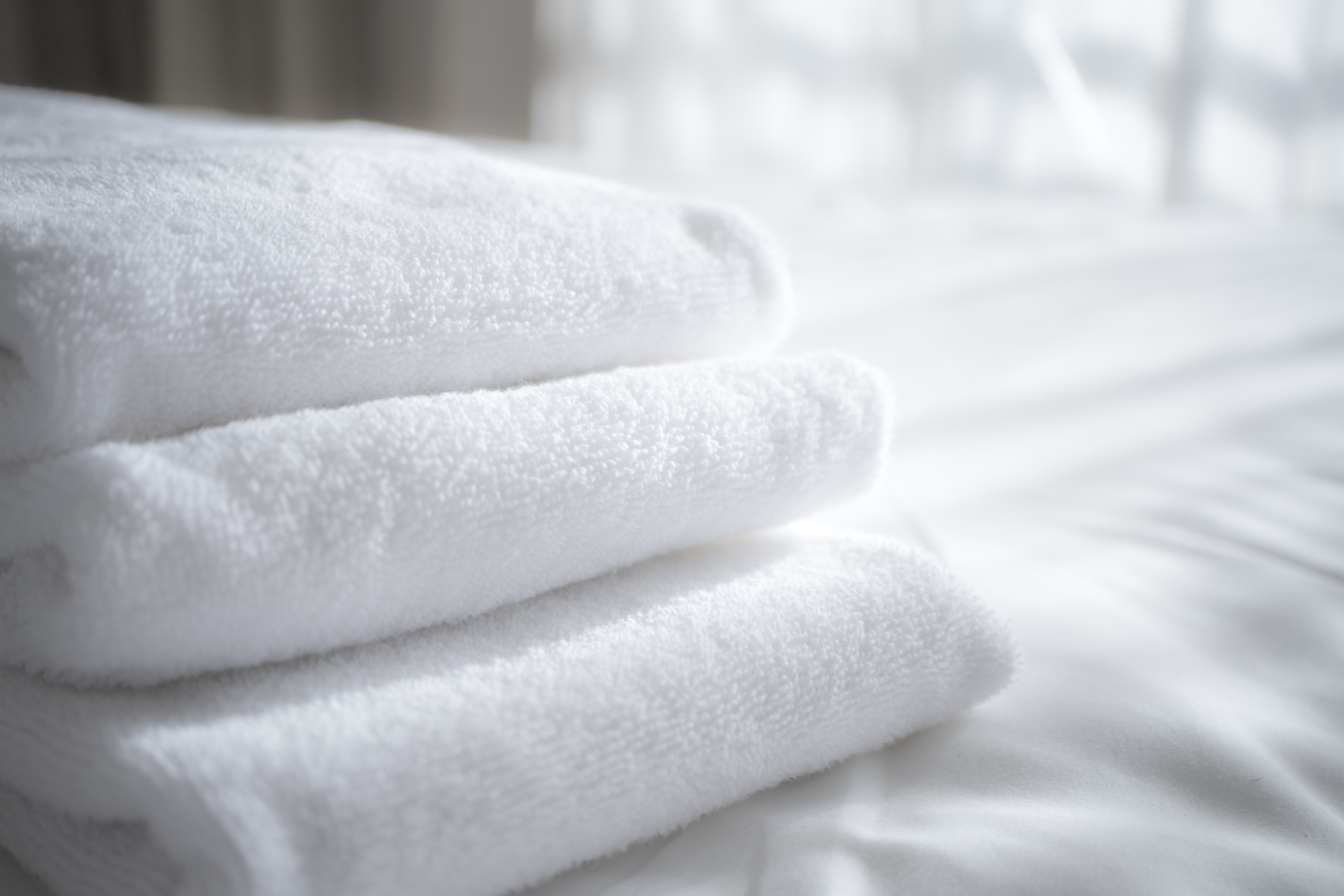 sun lights to the clean white towels on the hotel bed : feels cozy, comfort and relax. - for cozy feeling, i took with extra exposure and defocus shot