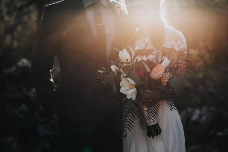 6 Essential Wedding Tasks That No One Will Tell You holding flowers