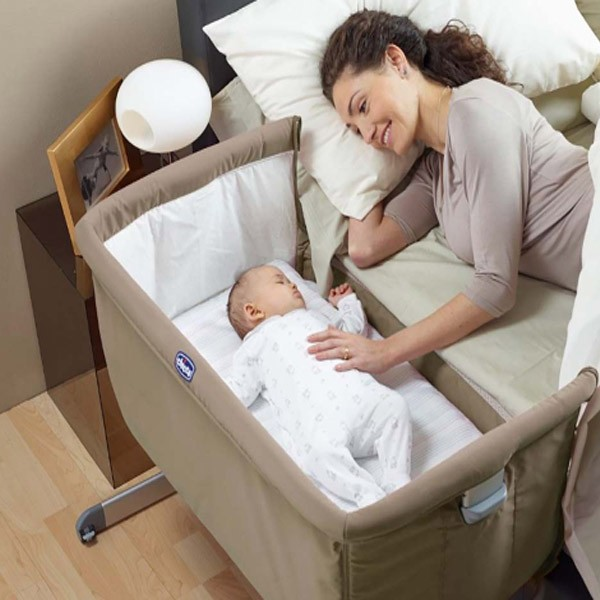 mother with baby in crib