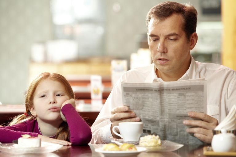 father reading book to child