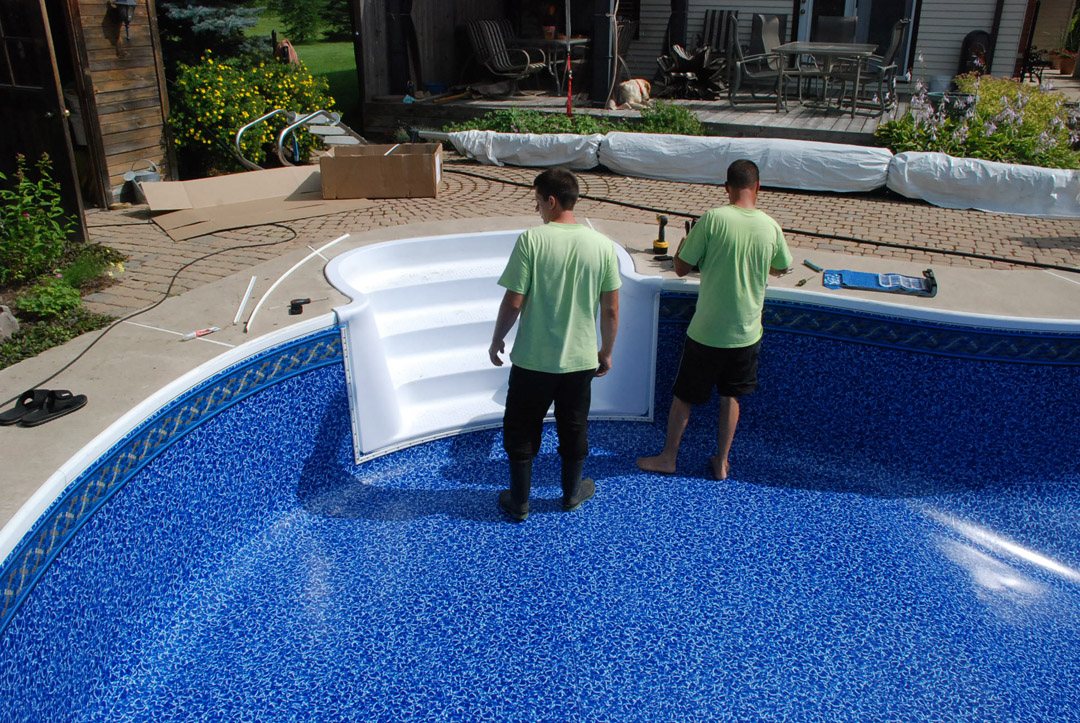 Should you bother renovating your swimming pool? workers