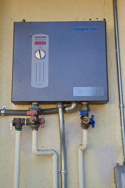Tankless water heater on side of Green home that is off the grid. Solar power and a rainwater harvesting system supply all the energy and water for...